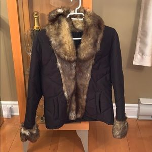 Light coat with faux fur trimming
